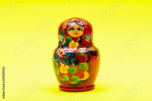 Colorful Nesting wooden Dolls isolated on bright yellow background. National Russian souvenirs. Babushkas or Matryoshkas.