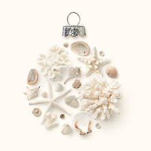 Christmas In July / At The Beach / In The Southern Hemisphere Concept With Holiday Ornament Made Of Shells, Starfish And Corals On A Cream Colored Background, Flat Lay / Top View, Copyspace