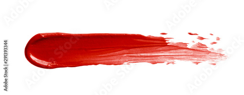 Fotografia  Red lipstick smear smudge swatch isolated on white background