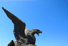 Statue Of Griffin Or Griffon Against The Sky. A Legendary Creature With The Body Of A Lion, The Head And Wings Of An Eagle. Ancient Mythology Fantasy