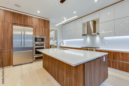 Interior design of a modern kitchen in the newly built house  with stainless steel appliances Fototapeta
