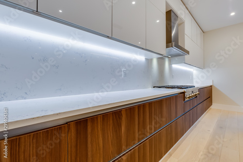 Interior design of a modern kitchen in the newly built house  with stainless steel appliances Tapéta, Fotótapéta