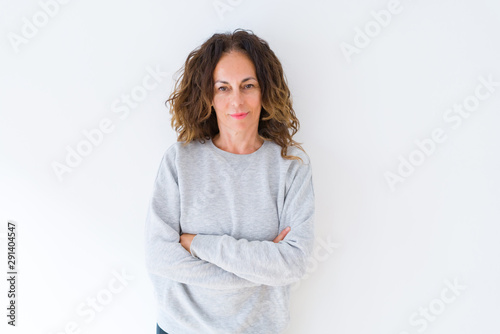 Pinturas sobre lienzo  Beautiful middle age woman with curly hair smiling cheerful and happy with arms