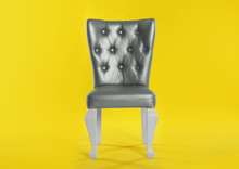 Stylish Silver Chair On Yellow Background. Element Of Interior Design