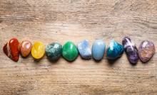 Flat Lay Composition With Different Gemstones On Wooden Table
