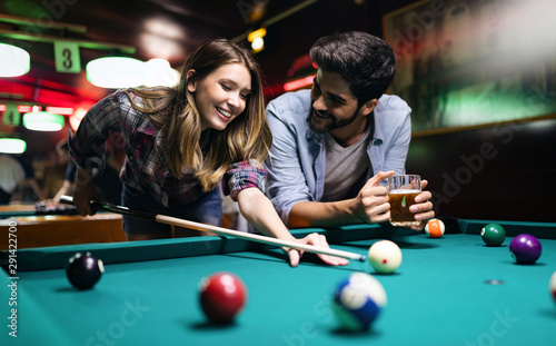 Fototapeta Couple dating, flirting and playing billiard in a pub obraz