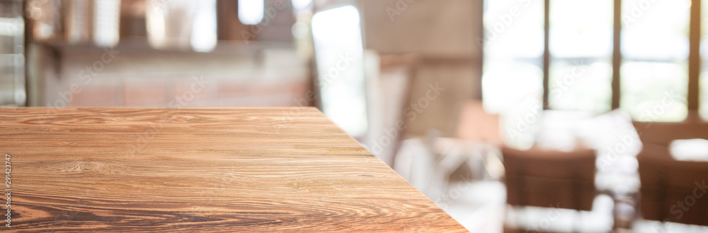 Fototapeta wood table top product display background with blur people in green cafe restaurant.left perspective wooden kitchen counter.Banner mockup presentation for your product online