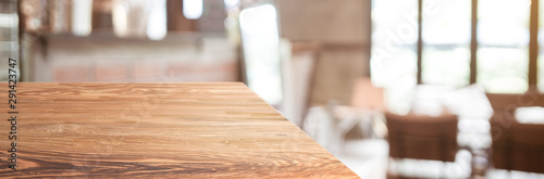 wood table top product display background with blur people in green cafe restaurant.left perspective wooden kitchen counter.Banner mockup presentation for your product online - 291423747