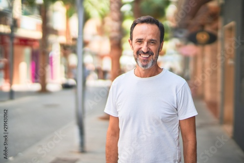 obraz PCV Middle age handsome man standing on the street smiling
