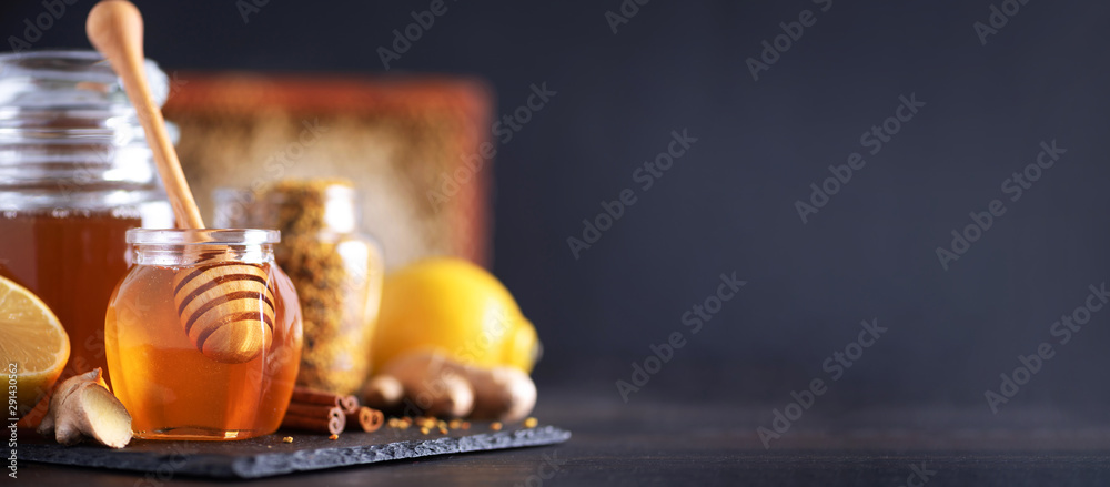 Fototapeta Ingredients for healthy hot drink. Lemon, ginger, mint, honey, apple and spices on dark background. Copy space. Alternative medicine concept. Clean eating, detox