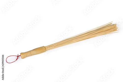 Bamboo massage broom on a white background Obraz na płótnie