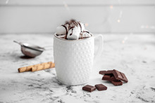 Cup Of Hot Chocolate With Marshmallows On White Table
