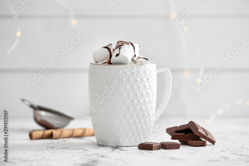Spoed Foto op Canvas Chocolade Cup of hot chocolate with marshmallows on white table
