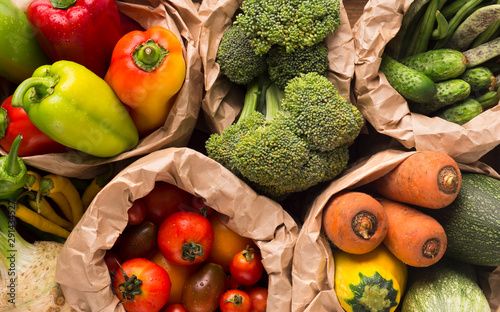 Summer background with fresh and healthy farm vegetables - 291434527