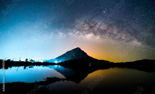 Montage in der Fensternische Schwarz Beautiful night landscape of milky way galaxy over the mountain and lake foreground. Long exposure photography of night sky.