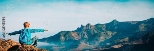 Obraz happy boy hiking in mountains, family travel concept - fototapety do salonu