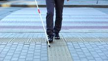 Visually Impaired Man Using Ta...