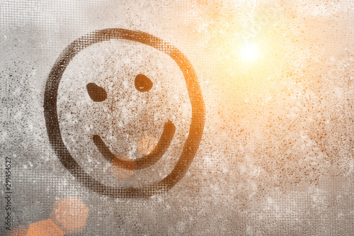 Emoji smile, Autumn rain, inscription on sweaty glass smiley with copy space for Canvas Print