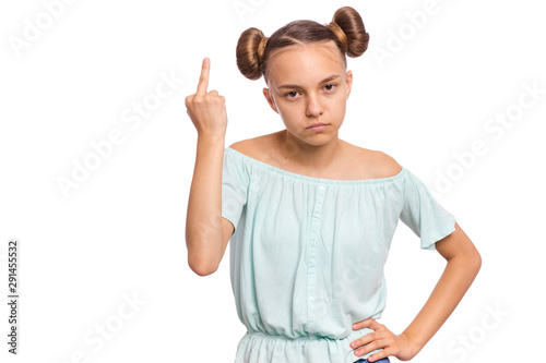 Fotografiet  Portrait of angry teen girl showing middle finger, isolated on white background