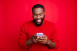 canvas print picture - Close-up portrait of his he nice attractive cheerful cheery glad bearded guy chatting 5g app wireless connection playing game isolated over bright vivid shine red background