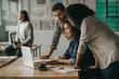 Leinwandbild Motiv Diverse group of designers working together on an office laptop