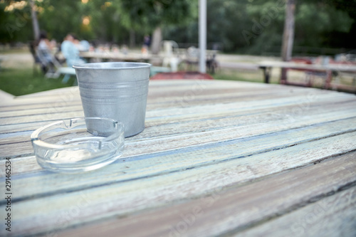 view of a wooden table on the terrace of a bar Canvas Print