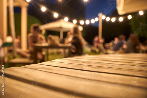 Canvas Print view of a wooden table on the terrace of a bar