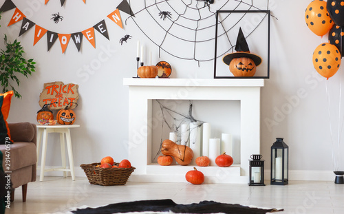 interior of house decorated for Halloween pumpkins, webs and spiders