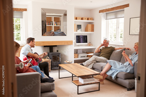 Fototapeta  Family With Senior Parents And Adult Offspring Relaxing In Lounge At Home Togeth