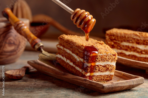 Foto op Canvas Brood Homemade layered honey cake with cream.