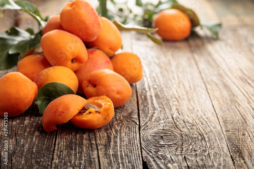 Fresh apricots on a old wooden table.