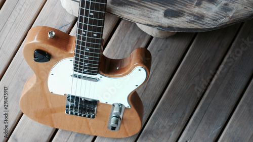Obraz na plátně  electric guitar on the wooden boards at country barn