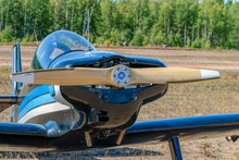 Frontal Close-up View Of Engine And Propeller Of Single-engined Light Airplane At Sunny Day.