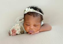 Sleppy Newborn With Toy
