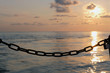 Silhouette of a chain and lock with sunset background