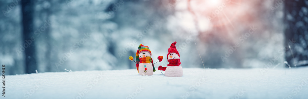 Fototapety, obrazy: little snowmans on soft snow on blue background