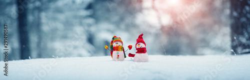 Fotografie, Obraz little snowmans on soft snow on blue background