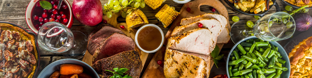 Fototapety, obrazy: Thanksgiving family dinner setting concept. Traditional Thanksgiving day food  with turkey, green beans and mashed potatoes, stuffing, pumpkin, apple and pecan pies, rustic wooden table
