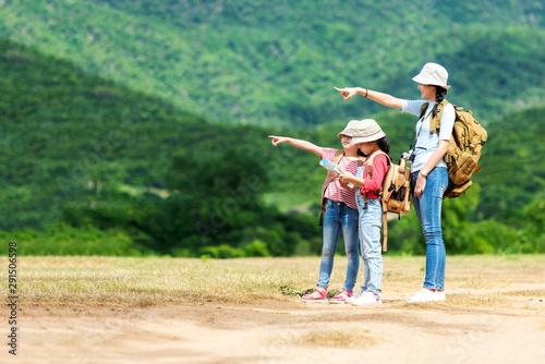 Valokuva Group asian family children checking map and pointing in the jungle adventure and tourism for destination leisure trips for education and relax in nature park