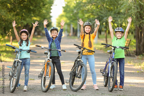 Obraz Cute children riding bicycles outdoors - fototapety do salonu
