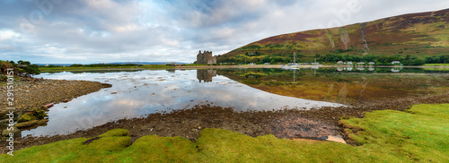 A panoramic view of the 13th century castle at Lochranza at high tide on the Isl Wallpaper Mural