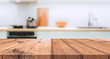 canvas print picture - Wood table top on blurred kitchen background