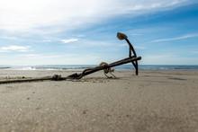 Rusty Boat Anchor On The Beach