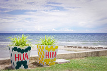 HUA HIN Letter Written On A Plant Pot, Landscape Of Beach And Sea In Pranburi Nearby Hua Hin, Thailand.