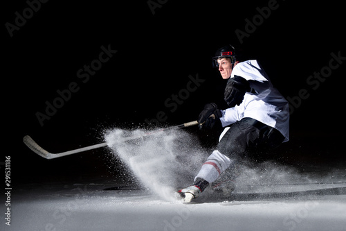 Fotografia  ice hockey player in action kicking with stick