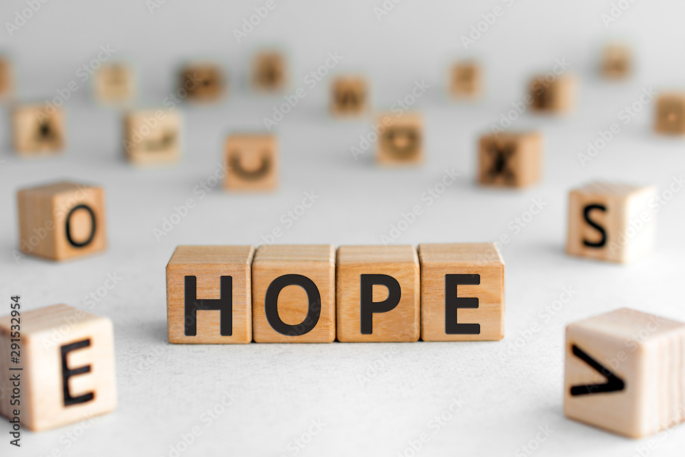 Fototapeta Hope - word from wooden blocks with letters, a feeling of trust hope concept, white background