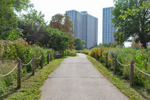 A Rope Fence Path Along The Lakefront Trail At A Park In Uptown Chicago With Residential Buildings