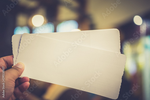 Empty paper air ticket in hand. Canvas Print
