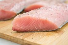 Raw Mahi Mahi (Dolphin Fish) Fillets On A Cutting Board