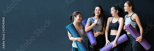 Fototapeta  Group of women of various nationalities standing and talking about yoga And equipment is mats That which type should be chosen to buy Happily because they are healthy, strong, beautiful body
